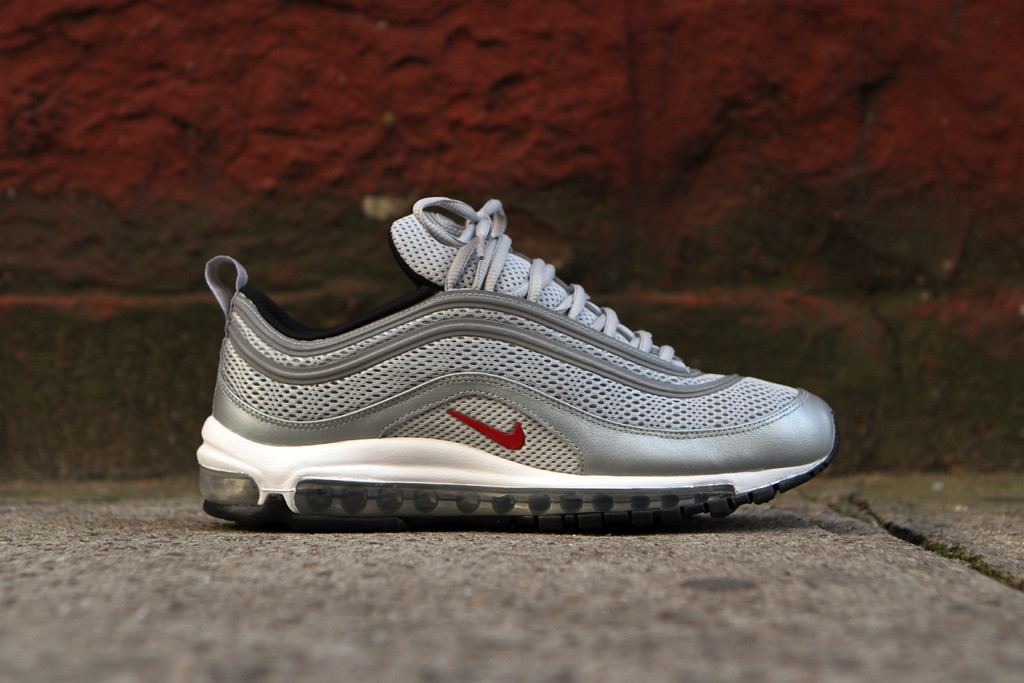 9f10709288 The Air Max 97 EM in the Metallic Silver/Varsity Red colorway is available  now at select Nike Sportswear retailers including Kith NYC.