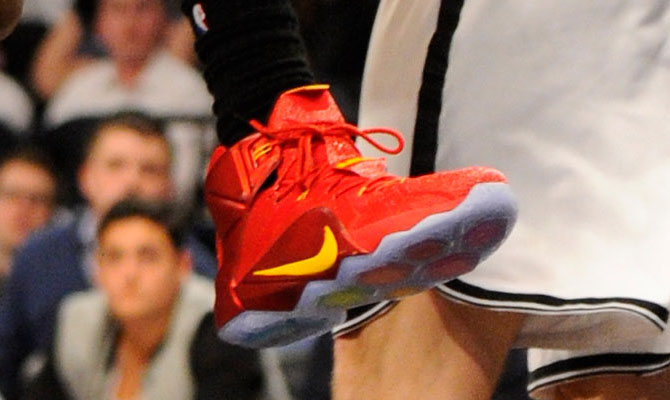 LeBron James wearing Nike LeBron XII 12 Red/Yellow PE on December 8, 2014
