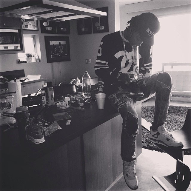 Wiz Khalifa wearing Air Jordan 4 Retro Cement