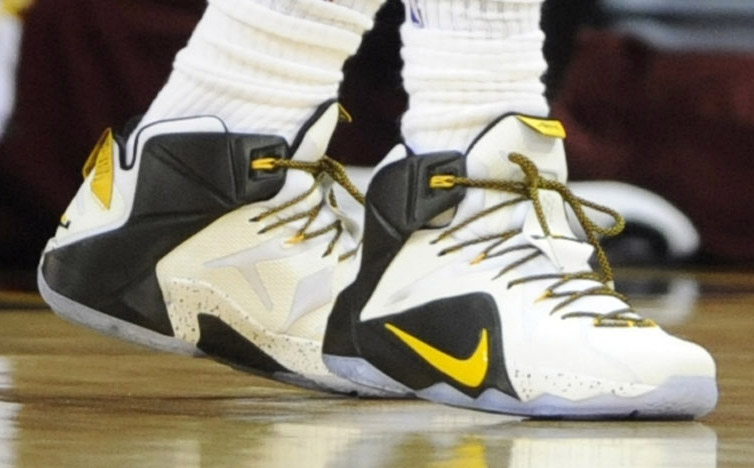 LeBron James wearing Nike LeBron XII 12 White/Black-Yellow PE on December 28, 2014