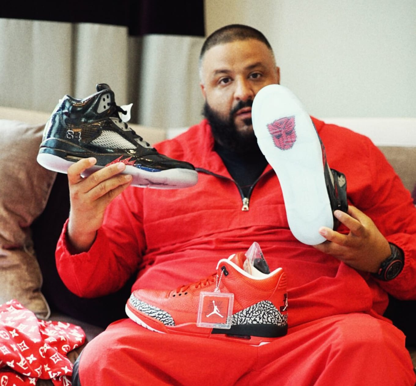 4d530ce8ea1f DJ Khaled Has Mark Wahlberg s  Transformers  Air Jordans. Membership has its  privileges.