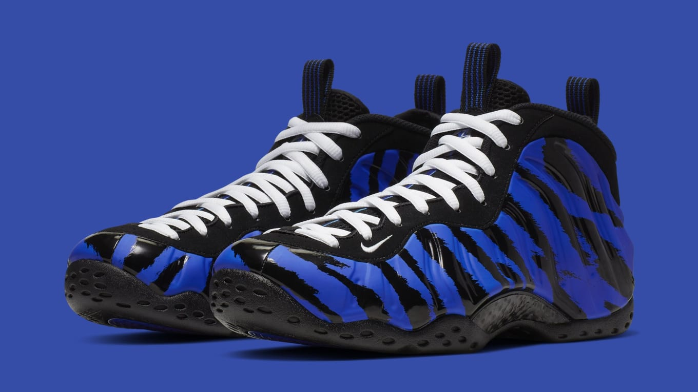 2eb5829eb4b  Tiger Stripes  Nike Air Foamposite One Is Releasing Soon. Former Memphis  Tigers PE launching in limited quantities.