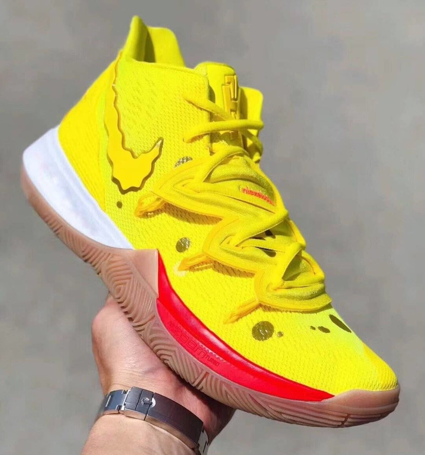 9a584901a1 Kyrie Irving Teams Up with SpongeBob SquarePants for Sneaker Collab. Nike  and Nickelodeon bring Nautical Nonsense to the Kyrie 5.