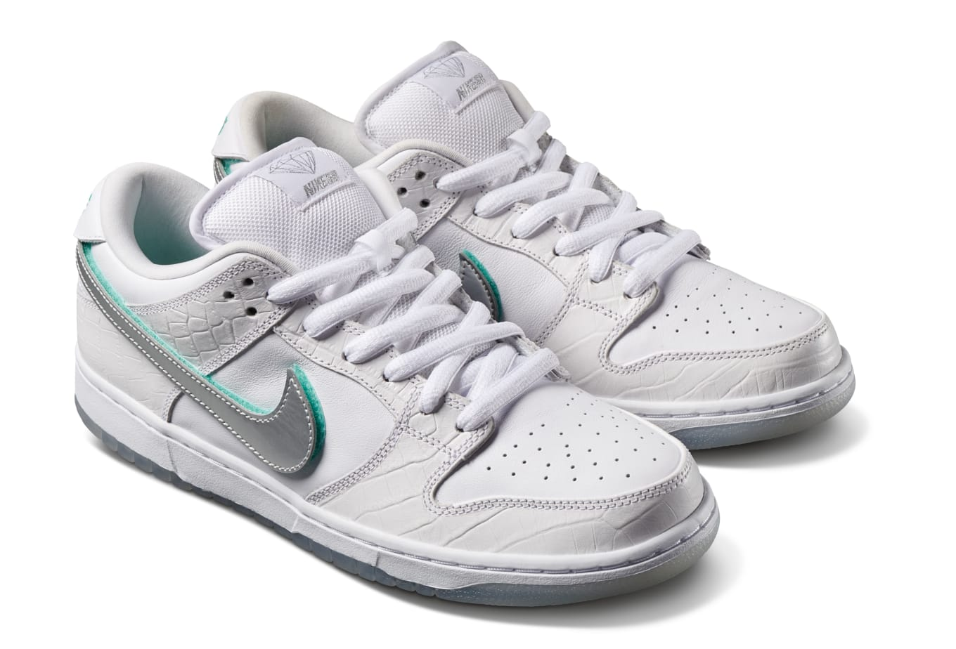 buy popular c505e 1b3bc Reveals SB Dunk Details. White colorway will drop exclusively at skate  shops.