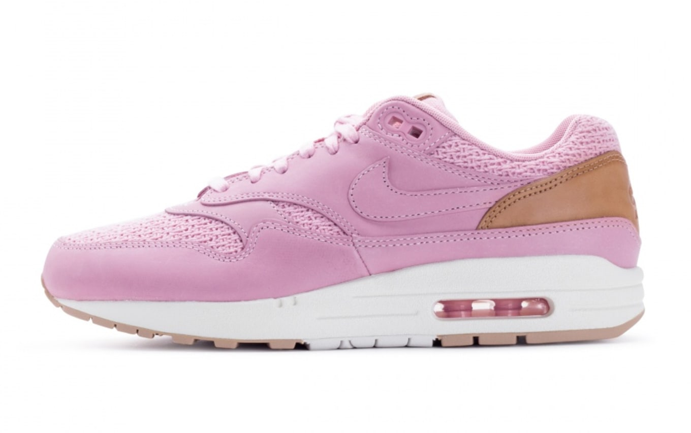 af7ad66a79 This Premium Nike Air Max 1 Is Pretty in Pink. Something new for the ladies.