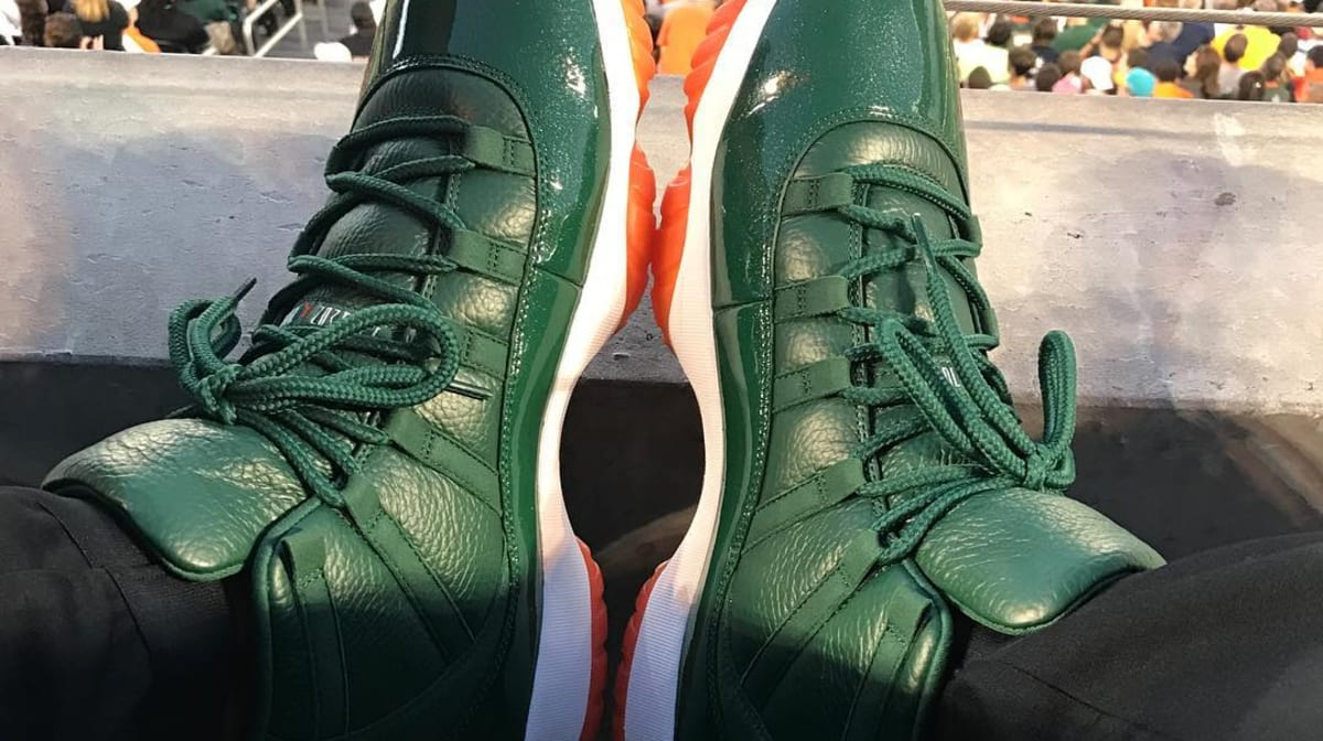 9b3e1d74652f Andre Johnson Air Jordan 11 Miami Hurricanes