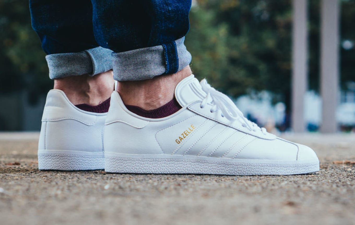 9449f4eeb7 Full grain leather replaces suede on these triple white Gazelles.