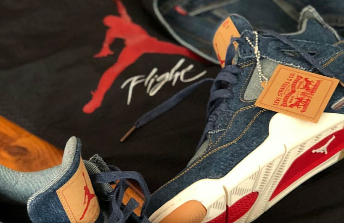 sale retailer 42299 3ad42 ... Levi s x Air Jordan 4 Blue Denim Release Date AO2571-401 Sole Collector  ...