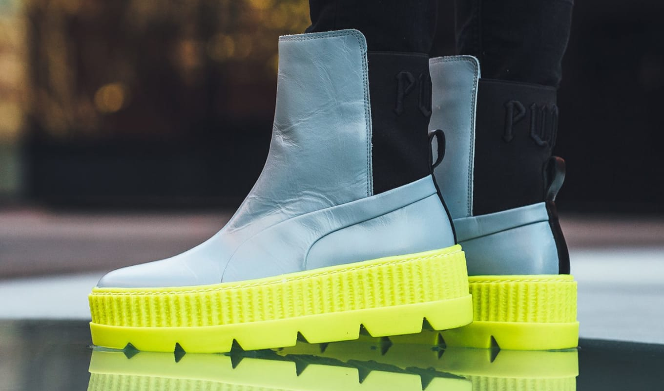 cbd9cd24e10b32 Rihanna and Puma Made a New Sneaker Boot for Winter. The Chelsea debuts in  two colorways.