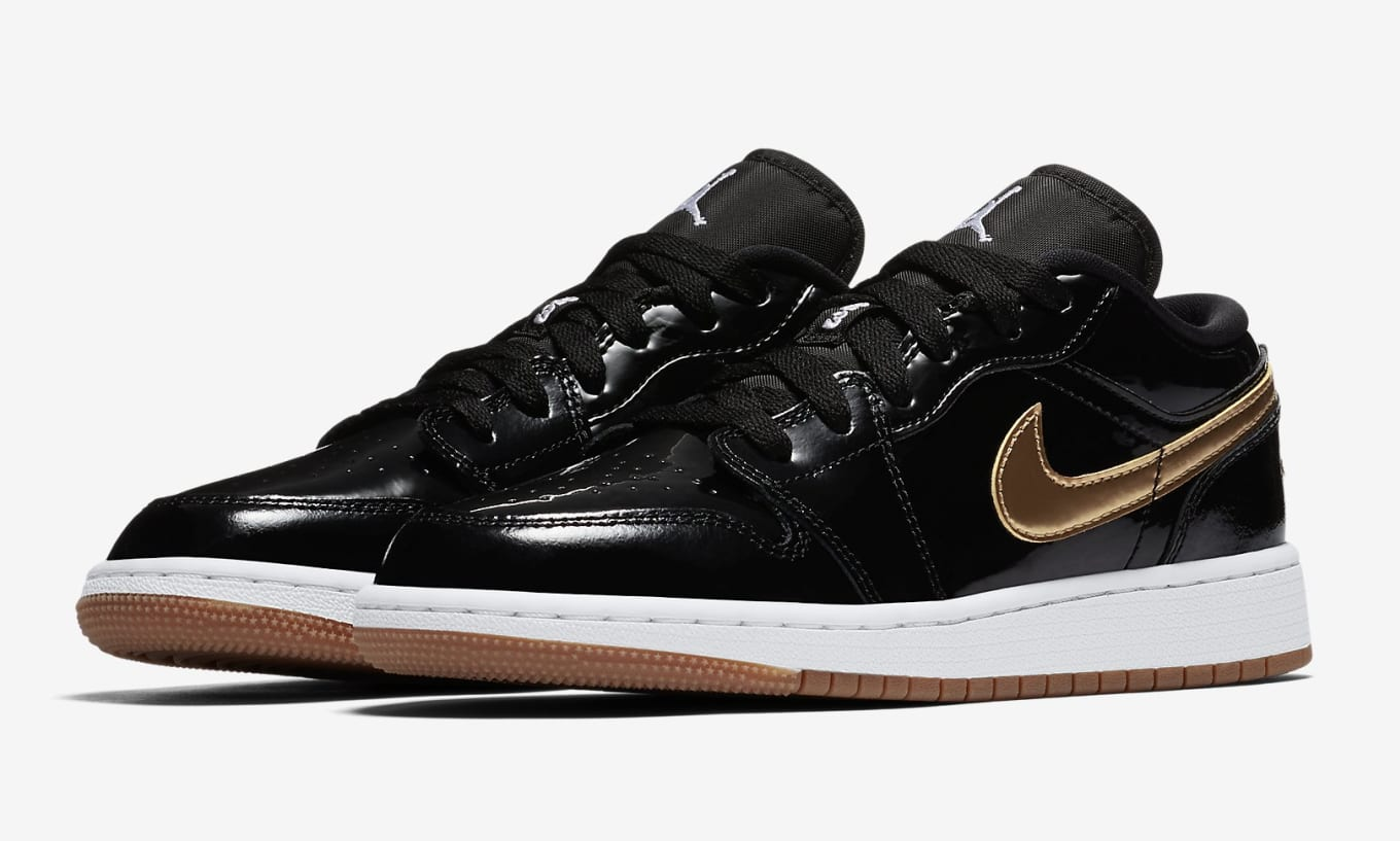 e059c1b7990e Black and Gold Return to the Air Jordan 1. These low tops are coming soon  for kids.