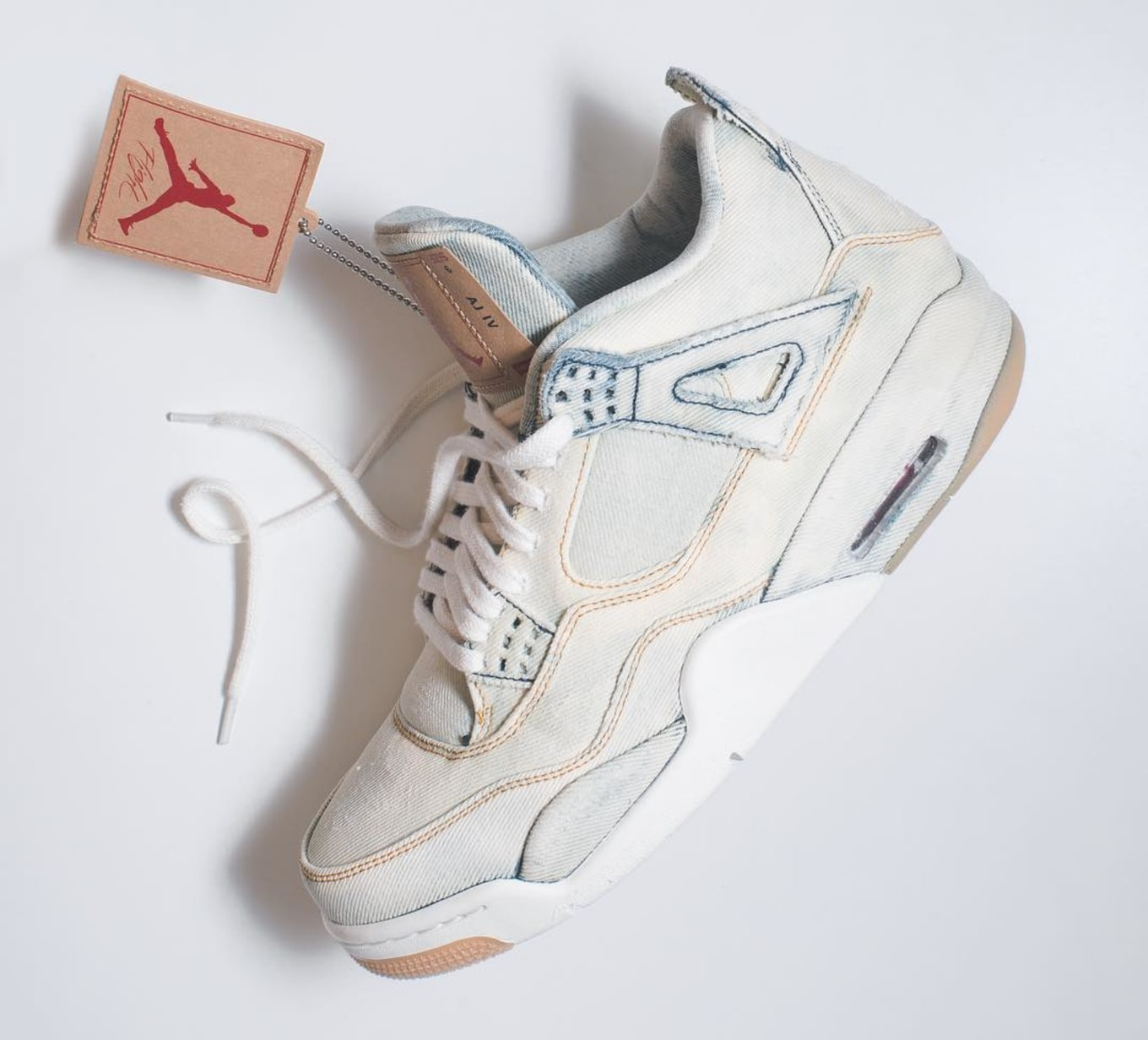 24b240585dc What the Levi's x Air Jordan 4 Looks Like with Bleached Denim. The latest  customization of the collaboration.