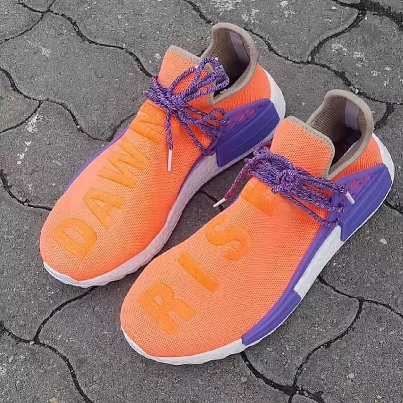 competitive price d8a78 c9452 Orange and Purple Featured on Unreleased Pharrell Adidas NMD.