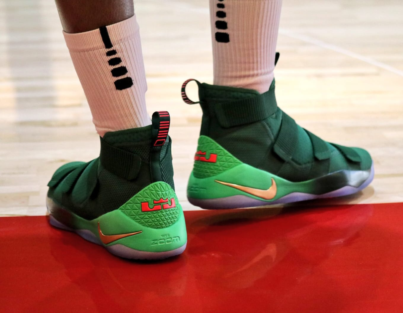 los angeles 8e3d1 f46c2 Nike Made Christmas Colorways of LeBron and Kobe s Sneakers. Festive  details on the Soldier 11 and Kobe A.D. Mid.