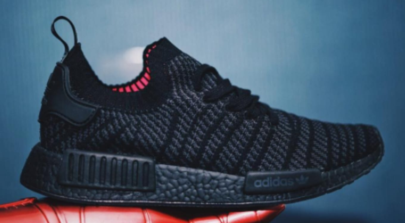 5795a89459d02 Adidas Is Releasing Another  Triple Black  NMD. A new colorway of the  NMD R1 STLT.