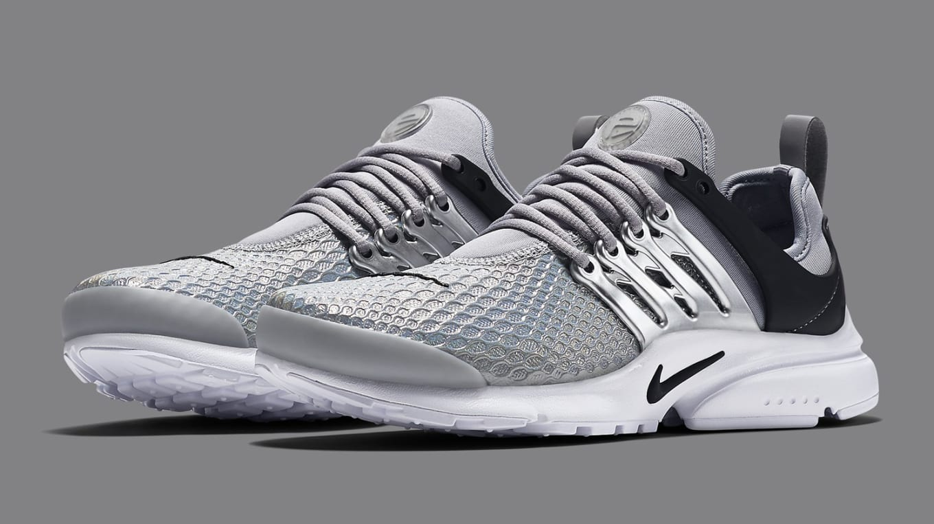 the latest f9a29 cee4c A metallic silver Nike Air Presto for women.