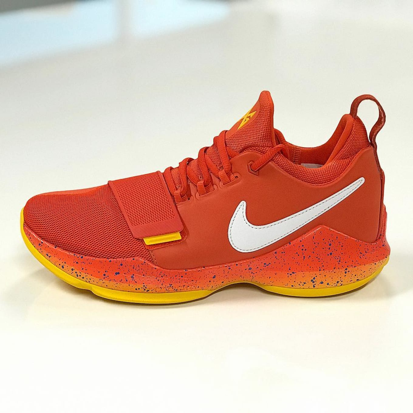 newest 45090 01c96 SoleWatch Paul George Shows Out in Bright Orange Nike PG1