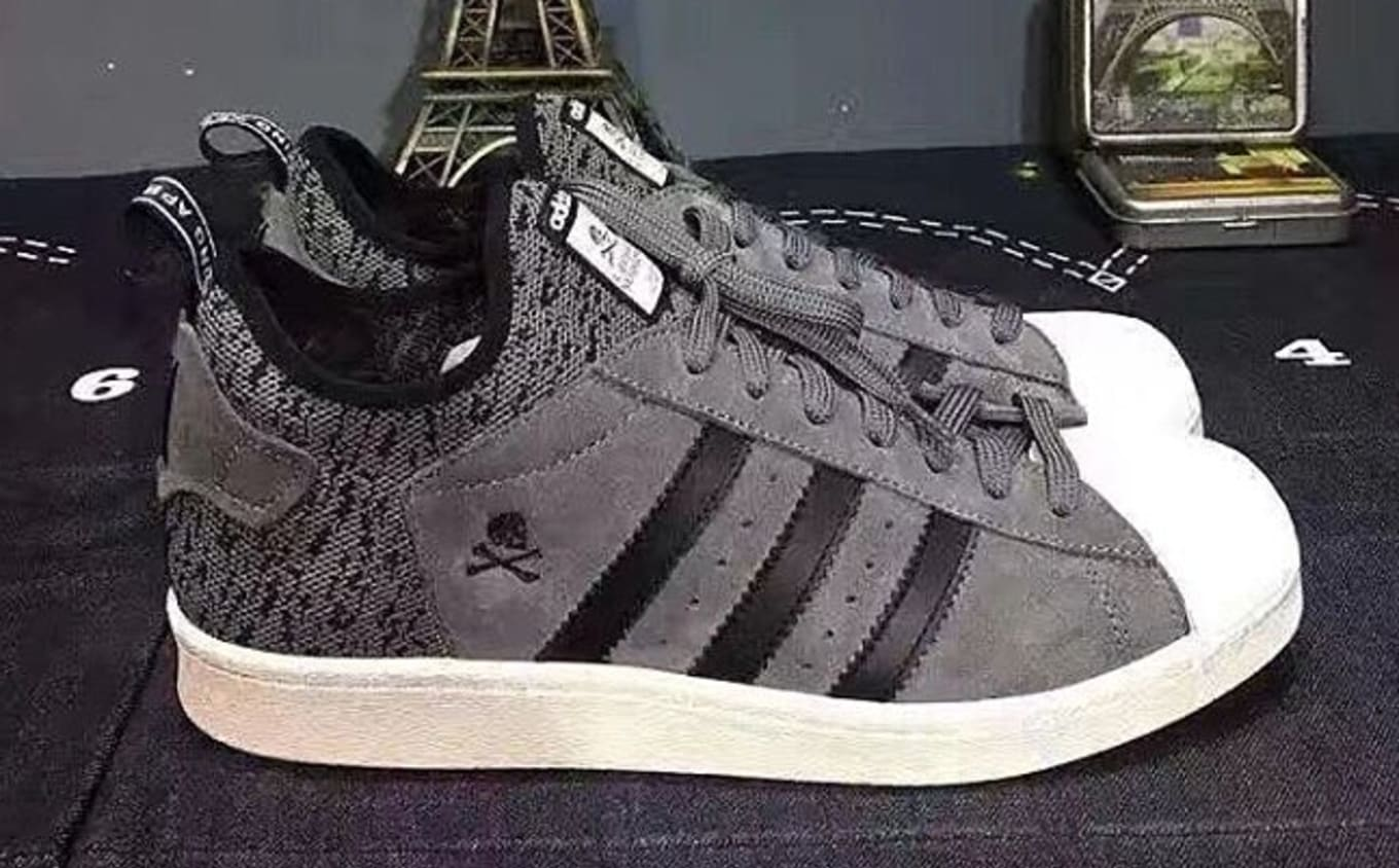 3e342e2279b70 ... Bape x Adidas Collaboration  Pro Model meets NMD on this fusion sneaker.