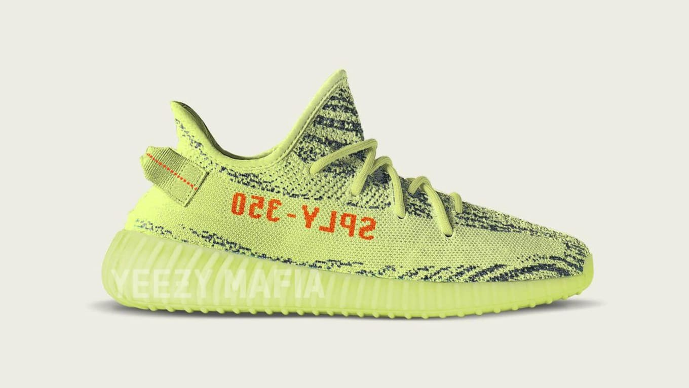 fafa80ba59ce Kanye West Wearing Semi Frozen Yellow Adidas Yeezy Boost