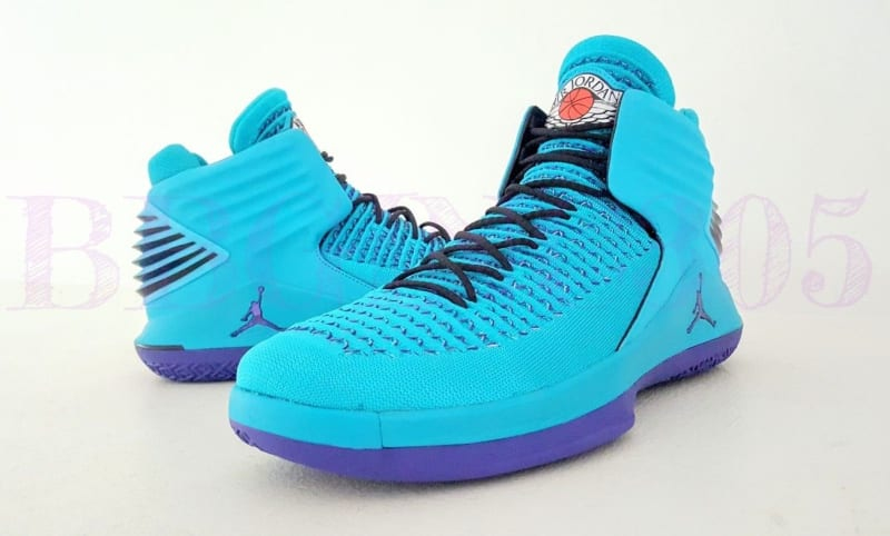 An Air Jordan 32 in a teal Charlotte Hornets colorway