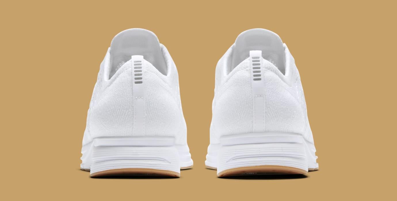 c53172590365ac Image via Nike Nike Flyknit Trainer  White Gum  AH8396-102 (Heel)