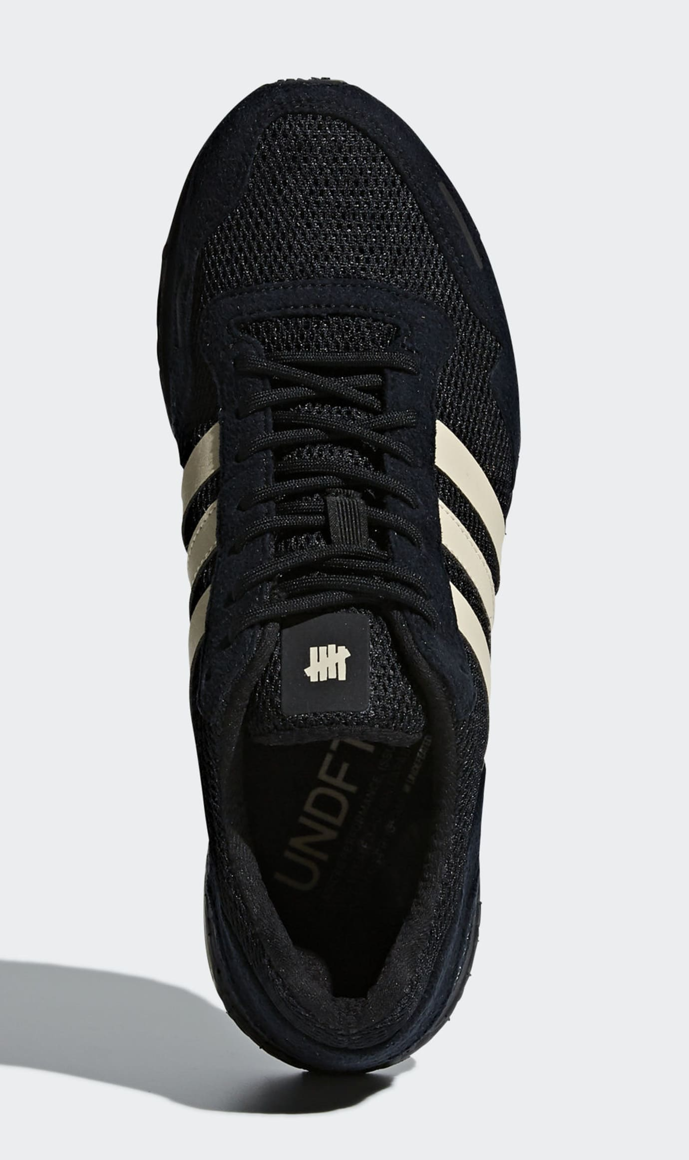 huge discount 438e0 07709 Image via Adidas Undefeated x Adidas Adizero Adios 3 B22483 (Top)