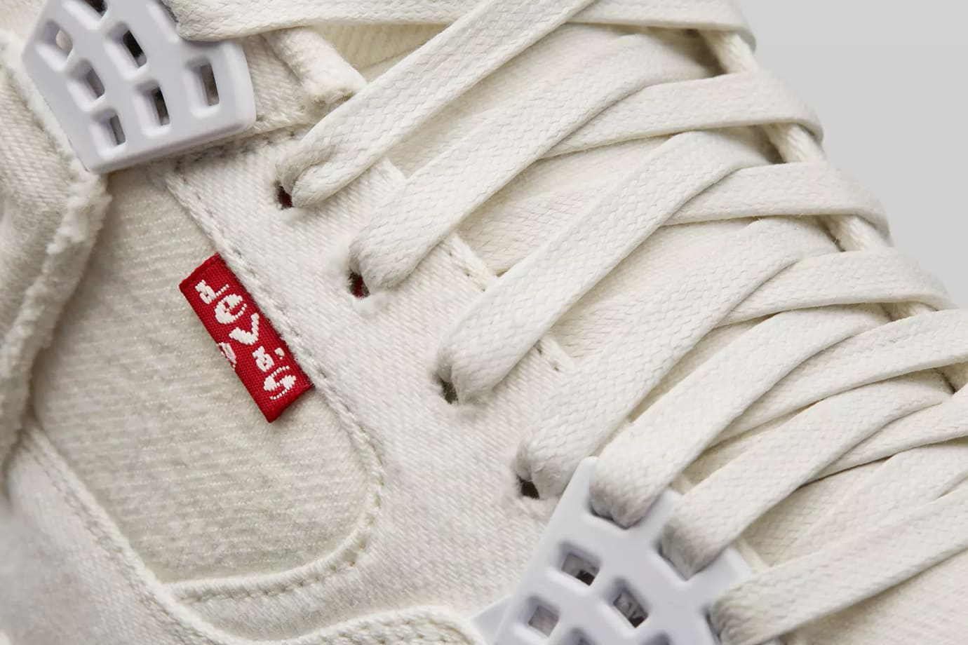 0c9f03eed60bac Image via Nike End Levi s x Air Jordan 4  White  AO2571-100 (Detail)