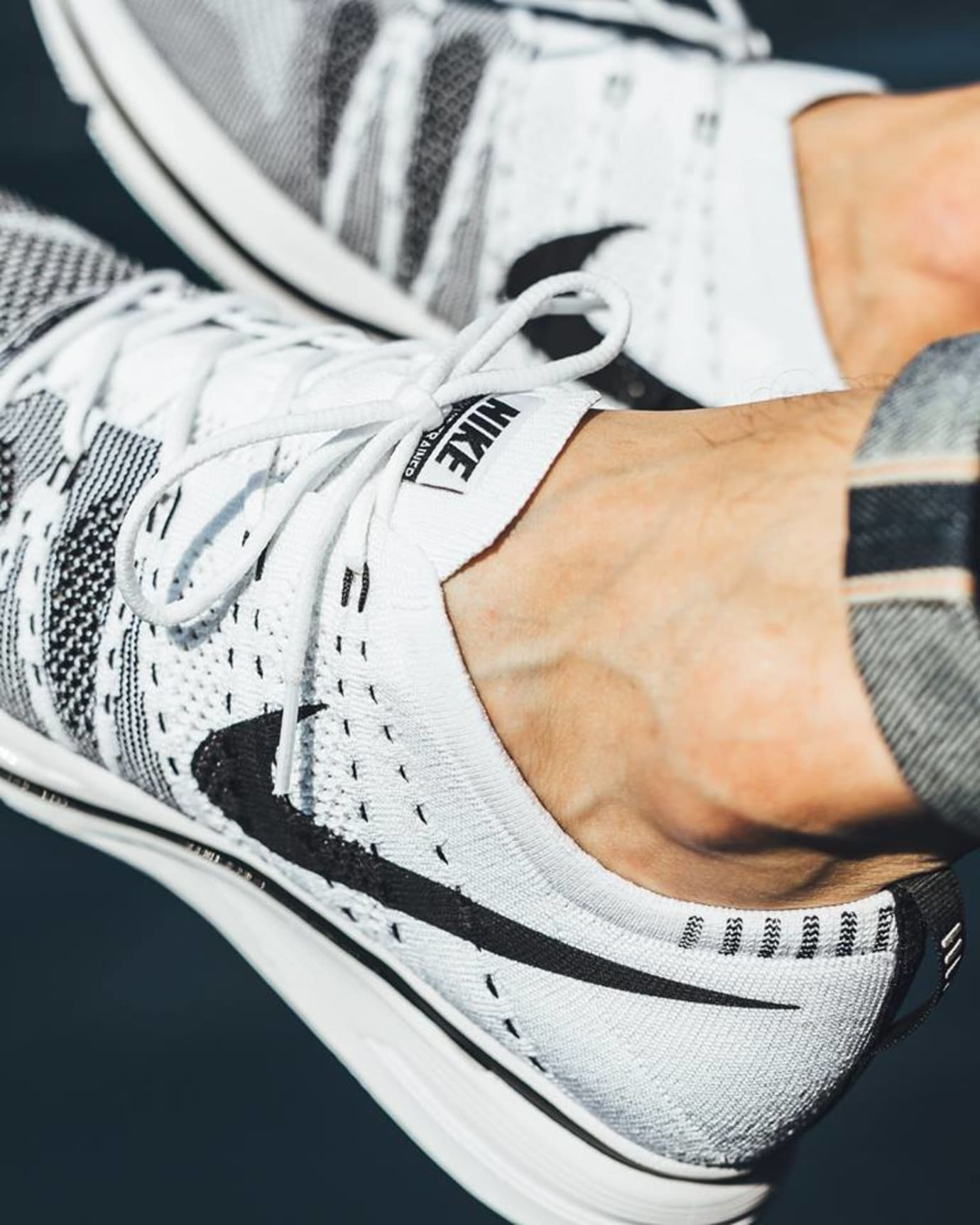 d56f7c2969d35 Image via Titolo White Black Nike Flyknit Trainer On Feet 2