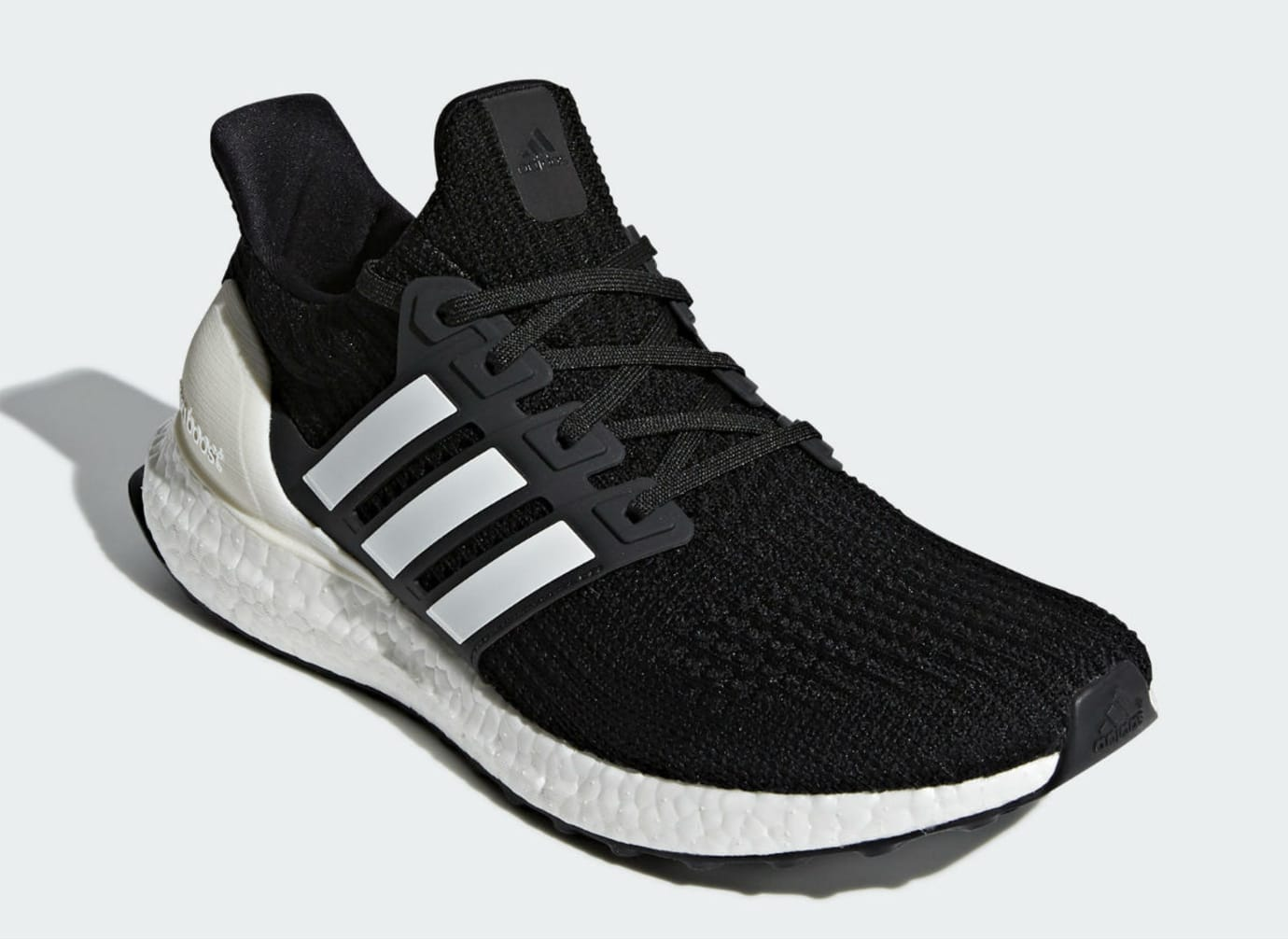 738e70e036b52 Image via Adidas Adidas Ultra Boost 4.0 Show Your Stripes Core Black Cloud  White Carbon Release date AQ0062 Front