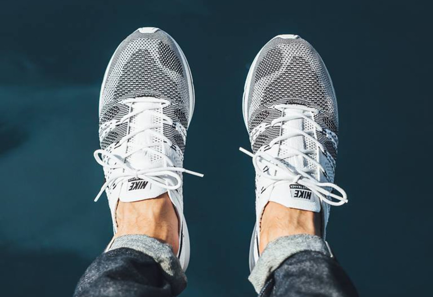 69b831d8451 Image via Titolo White Black Nike Flyknit Trainer On Feet 3