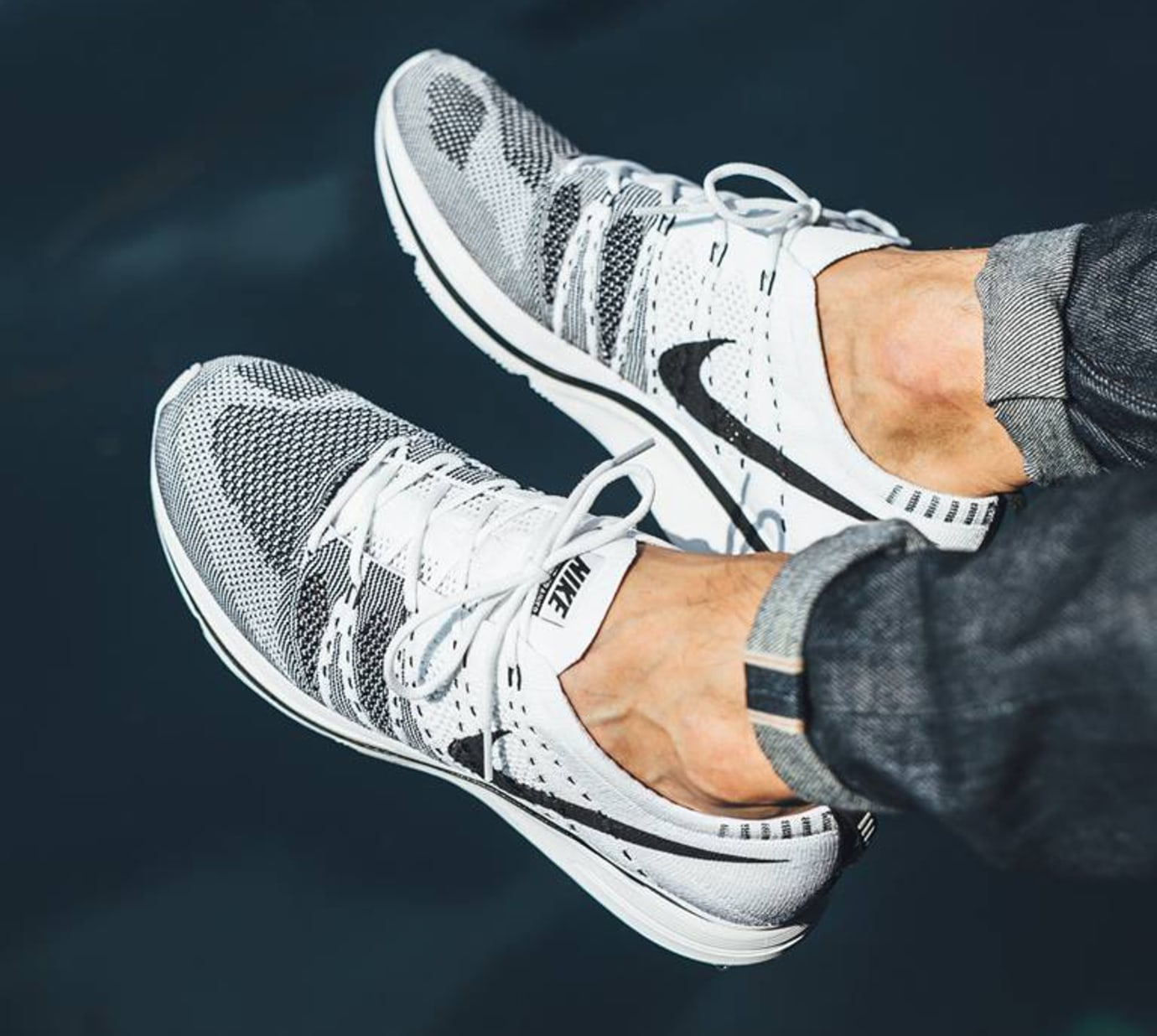 fc4e2ef434ce2 Image via Titolo White Black Nike Flyknit Trainer On Feet 4