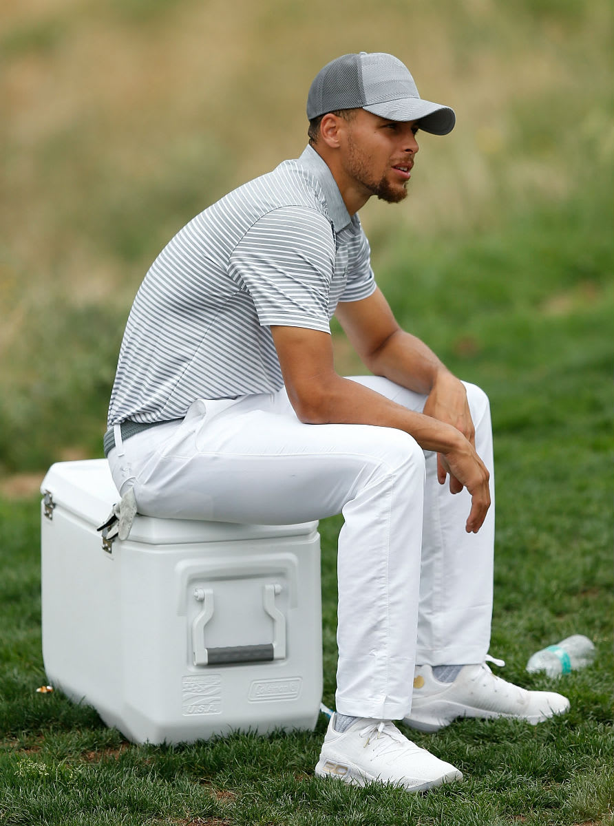 Stephen Curry Golfs in the White/Gold Under Armour Curry 4 Low (2)