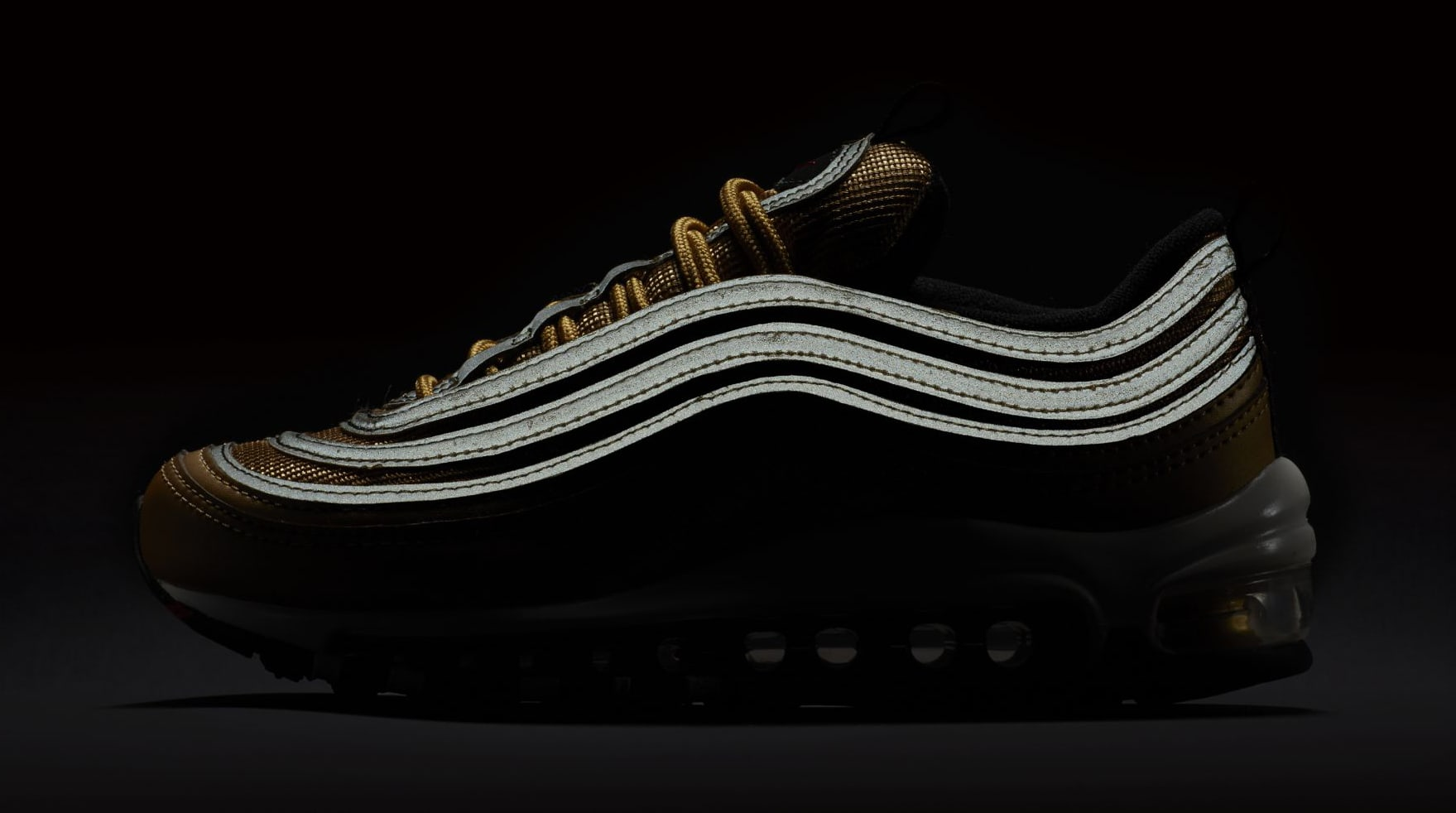 Image via NikeUS11 · Gold Nike Air Max 97 GS Reflective