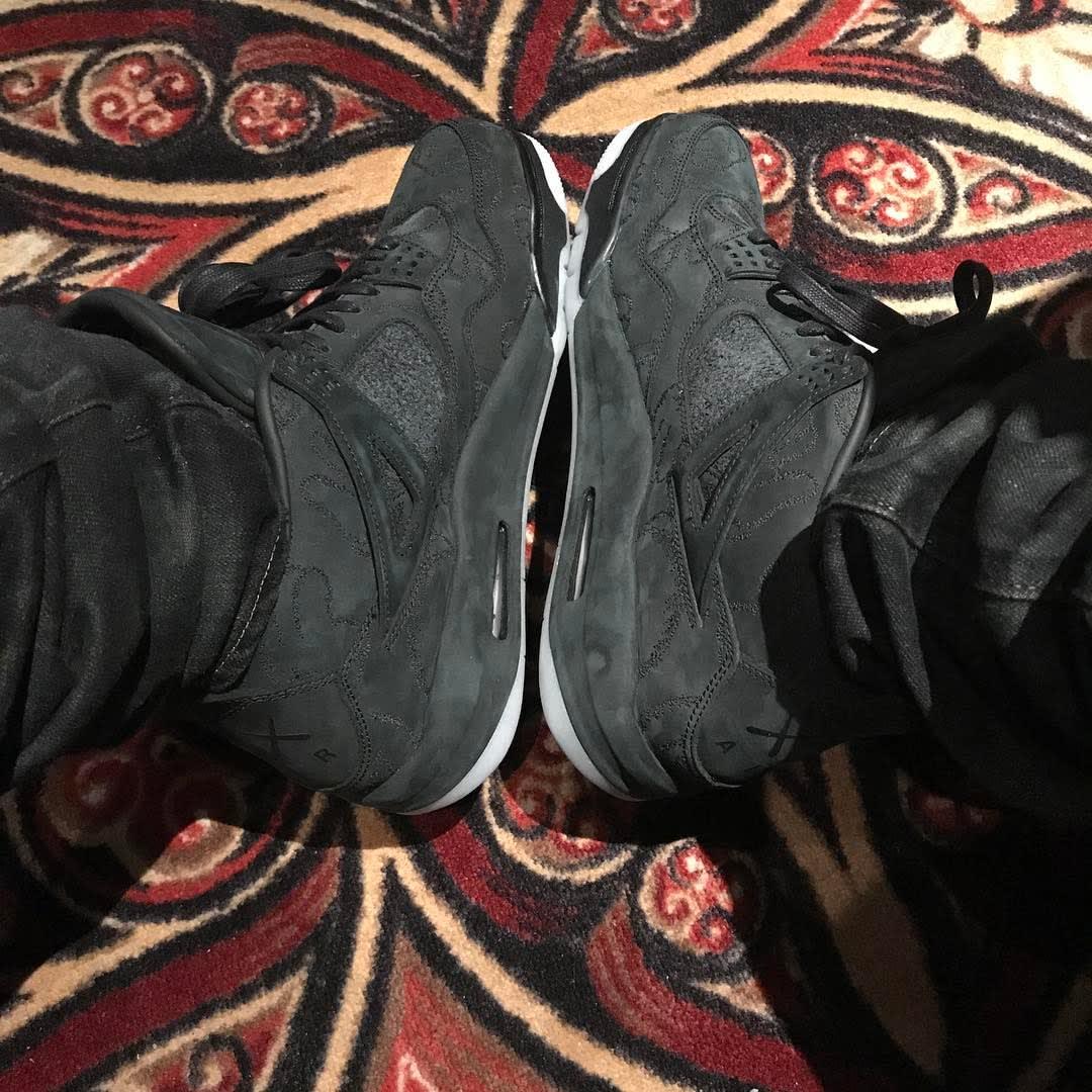 Drake Kaws Air Jordan 4 Black On-Foot