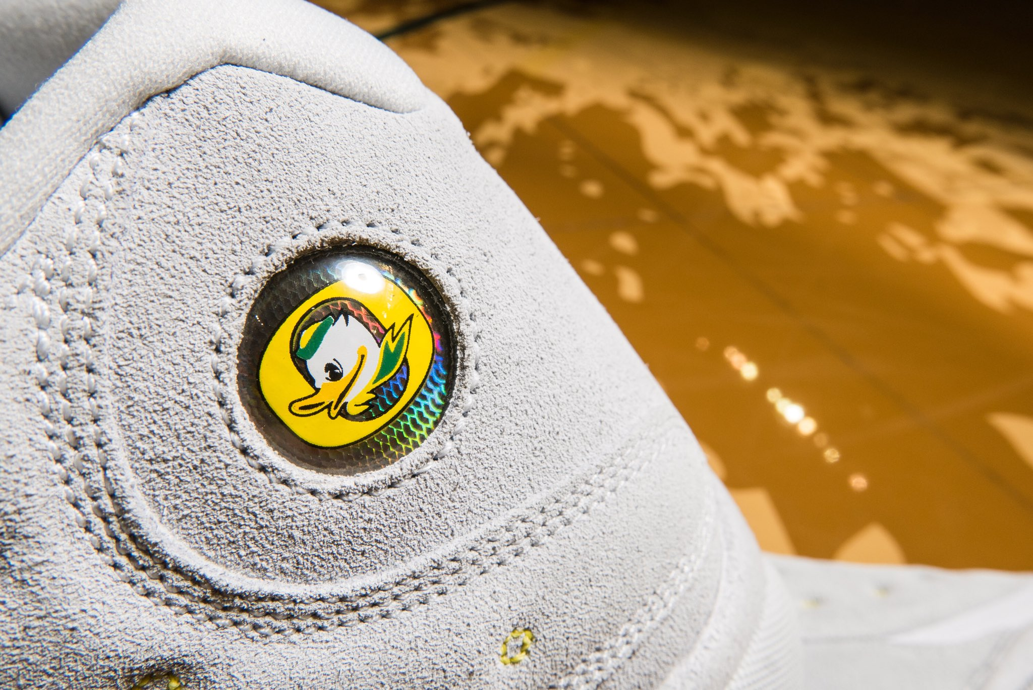 6c5ec08ea625 Air Jordan 13  Oregon Ducks  surfaces.