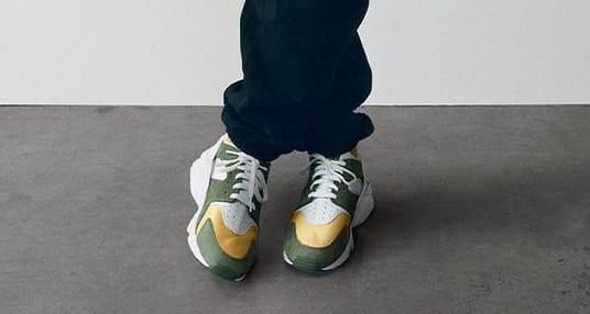 Stussy x Nike Air Huaruache 'Dark Olive/White/Varsity Maize/Ivory'